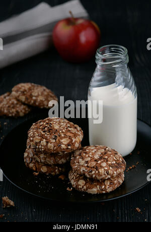 Still life with milk and homemade whole grain cookies - Stock Photo