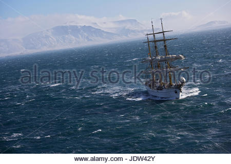 Traditional boat sailing on ocean, German Navy sail boat 'Gorch Fock' in waters close to Reykjavik, Iceland - Stock Photo
