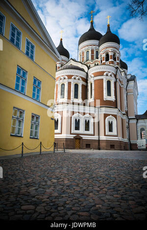 Tallinn orthodox cathedral by cobblestones in medieval old town - Stock Photo