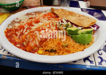 Enchiladas and Fish Taco with Rice and Beans - Stock Photo
