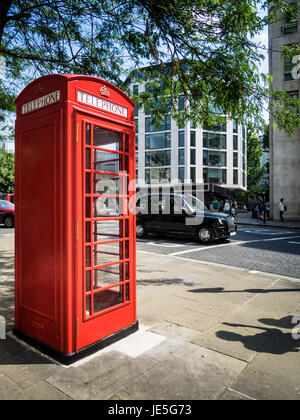A Traditional Red Phone box in the City of London Financial District UK - Stock Photo