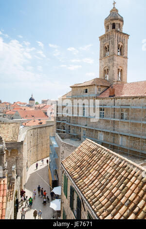 Bell tower of the Dominican monastery and museum overlooking the medieval city of Dubrovnik in Croatia - Stock Photo
