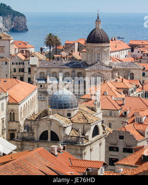 View from the massive defensive walls enclosing the beautiful red roofed medieval city of Dubrovnik on the Dalmation - Stock Photo