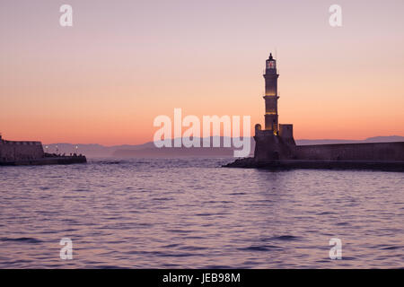 Sunset over Chania lighthouse, Chania Old Town, Crete, Greece - Stock Photo