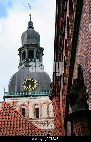 travel to Latvia - tower of Riga Cathedral (Rigas Doms) over old houses in autumn - Stock Photo