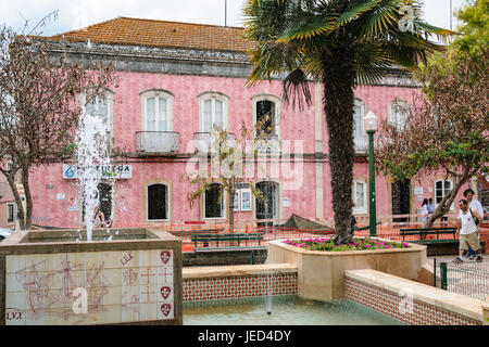 SILVES, PORTUGAL - JUNE 27, 2006: people near fountain on street Rua 25 de Abril in Sives city. Silves town is the - Stock Photo