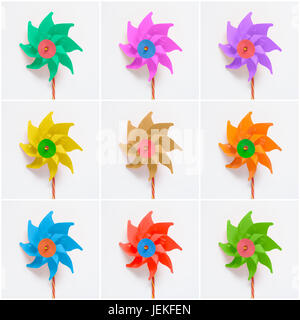 Collage of colorful pinwheels on white paper background - Stock Photo