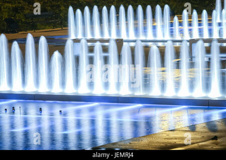 Water fountains at night in Zagreb, Croatia. - Stock Photo