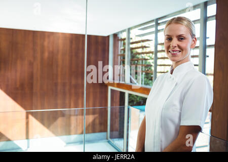 Portrait of smiling masseuse - Stock Photo
