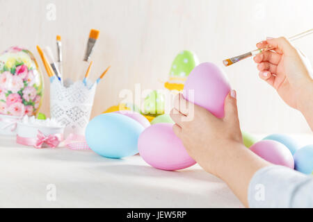 Easter egg painting in a workshop. Artistic hobby. Unique handmade decoration - Stock Photo