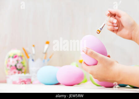 Easter egg painting in an atelier. Artistic handicraft, unique. - Stock Photo