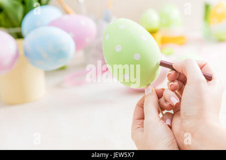 Pastel Easter egg handcrafted. Handmade decoration. - Stock Photo