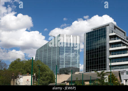 LONDON, ENGLAND - JULY 12, 2017 Modern multi-storey houses near Canary Wharf - Stock Photo