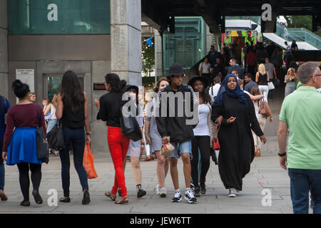 LONDON, ENGLAND - JULY 12, 2017 Motley crowd walking through South bank. - Stock Photo