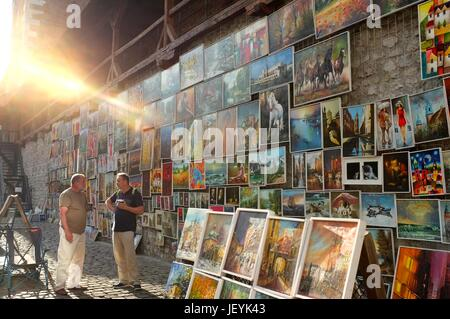 Paintings and artwork on sale in the Old Town of Krakow, Poland, Central/Eastern Europe, June 2017. - Stock Photo