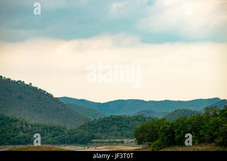 Lake with mountain range in Kaeng Krachan National Park, Phetchaburi, Thailand. - Stock Photo