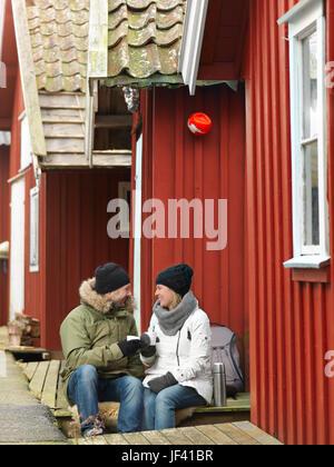 Smiling couple having coffee break - Stock Photo
