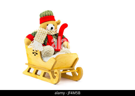 Christmas bear in wooden sleigh on white - Stock Photo