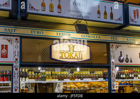 Tokaji stall selling wine and bread with an large display of bottles inside the covered Central Market Hall (Vasarcsarnok), - Stock Photo