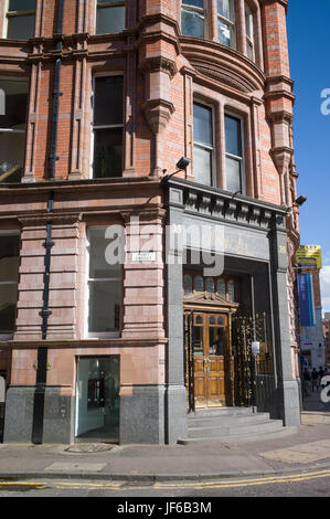 Brick and stone Victorian commercial building on corner of Port and Dale Streets, Manchester, UK - Stock Photo