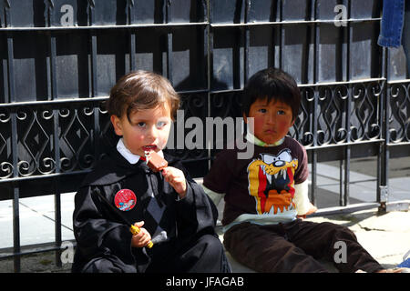 La Paz, Bolivia, 30th June 2017. A young boy dressed as a magician enjoys an ice cream at an event organised by - Stock Photo