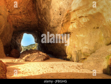 Open cave at One Thousand Steps Beach - Stock Photo