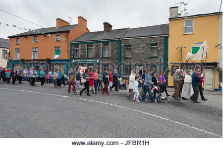 A Corpus Christi procession parades through Milltown, Ireland. - Stock Photo