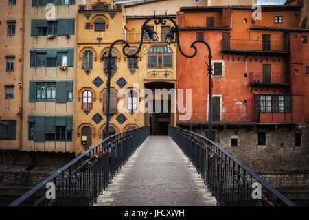 Picturesque aged houses in Girona Old Town, view from the Gomez Bridge (Pont de la Princesa), Gerona, Catalonia, - Stock Photo