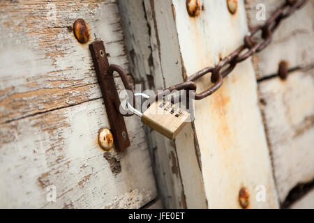 A chained and padlocked door - Stock Photo