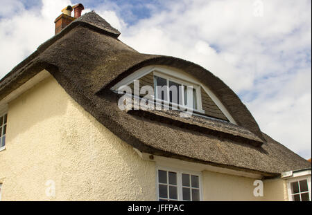 A beautiful example of a traditional thatched roof on a two storey property in Bosham in west sussex in the South - Stock Photo