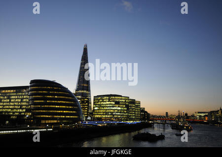 View along River Thames to City Hall and The Shard at Dusk with HMS Belfast moored in the Thames, London, England - Stock Photo