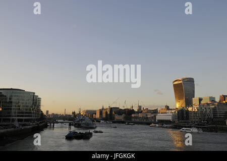 View from Tower Bridge along the River Thames and HMS Belfast and City of London including The Walkie Talkie Building - Stock Photo