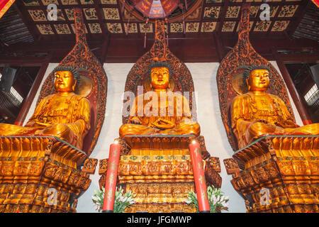 China, Shanghai, Jade Buddha Temple, Buddha Statues in The Great Hall - Stock Photo