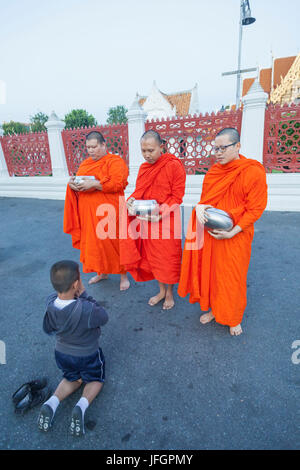 Thailand, Bangkok, Wat Benchamabophit aka The Marble Temple, Child Praying to Monks - Stock Photo