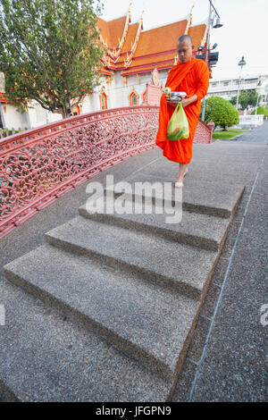 Thailand, Bangkok, Wat Benchamabophit aka The Marble Temple, Monks Walking Over Arched Bridge - Stock Photo