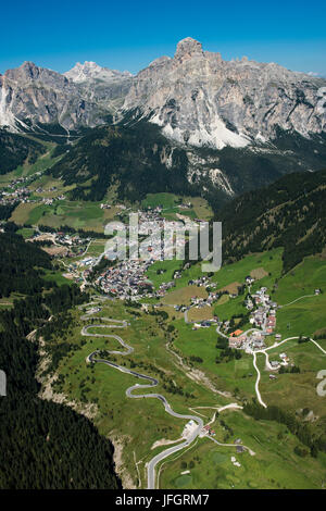 Corvara with Sassongher, dolomites, aerial picture, high mountain valley, South Tirol, Italy - Stock Photo