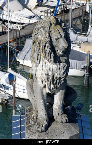 View of the lighthouse, lion in the port entrance, harbour of Lindau, Lake of Constance, Bavarians, Germany - Stock Photo