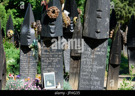Szatmarczeke , Hungary. Wooden boat shaped gravestones on the cemetery - Stock Photo