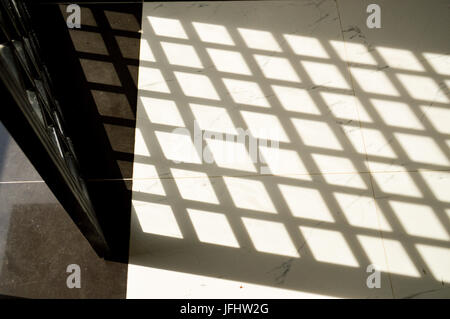Shadows reflected on the floor - Stock Photo