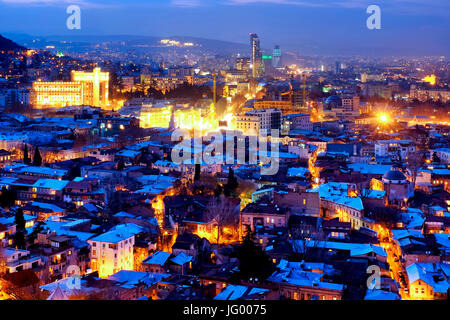 View of Tbilisi taken from Narikala fortress at night, Tbilisi, Georgia - Stock Photo
