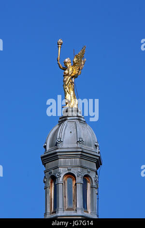 CROATIA ZAGREB, 30 JUNE 2017: Statue of an angel of enlightenment on a building in Zagreb - Stock Photo