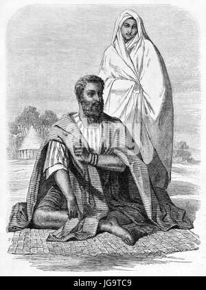 Old engraved portrait of Moorish man and woman in the Emirate of Trarza. Created by De Bérard after Raffenel, published - Stock Photo