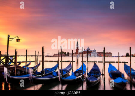Dawn over the Grand Canal in Venice, Italy.  The island of San Giorgio is in the background - Stock Photo