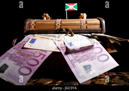 Burundian flag on top of crate full of money - Stock Photo