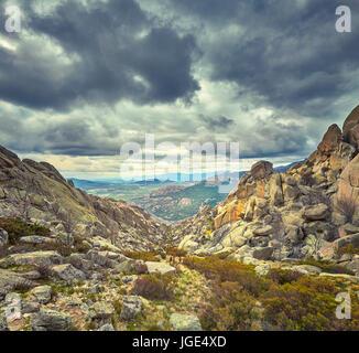 Descending from The Yelmo cliff in the Pedriza Parque Regional de la Cuenca Alta del Manzanares Sierra de Guadarrama. - Stock Photo
