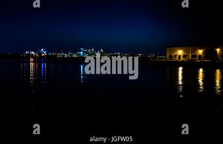 Baltimore, USA - June 11, 2017: Cityscape or skyline of city in Maryland at night with water - Stock Photo