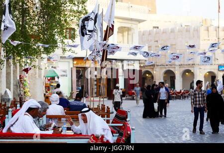 DOHA, QATAR - JULY 6, 2017: Flags and bunting with the image of  Qatari Emir Sheikh Tamim bin Hamad in the capital's - Stock Photo