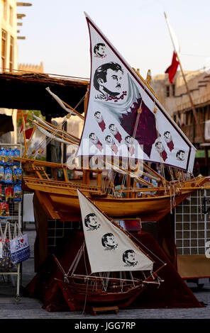 Model dhows with images of Qatari ruler Sheikh Tamim on sale in Souq Waqif, Qatar, July 6, 2017, in a show of loyalty - Stock Photo