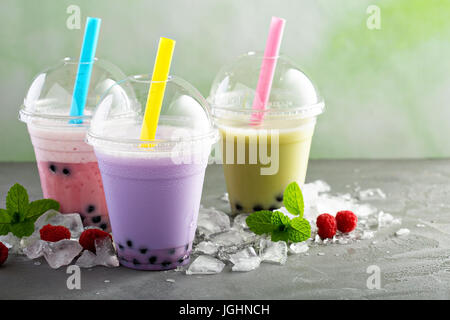 Variety of bubble tea in plastic cups - Stock Photo