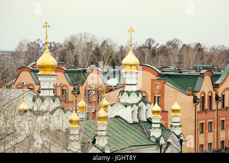 Church with domes. Green roof. City religious landscape - Stock Photo